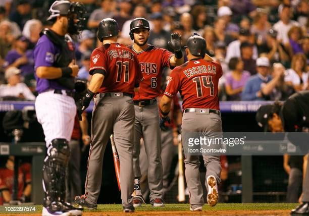 Arizona Diamondbacks outfielder David Peralta congratulates outfielder AJ Pollock and infielder Eduardo Escobar following a tworun homerun by Escobar...