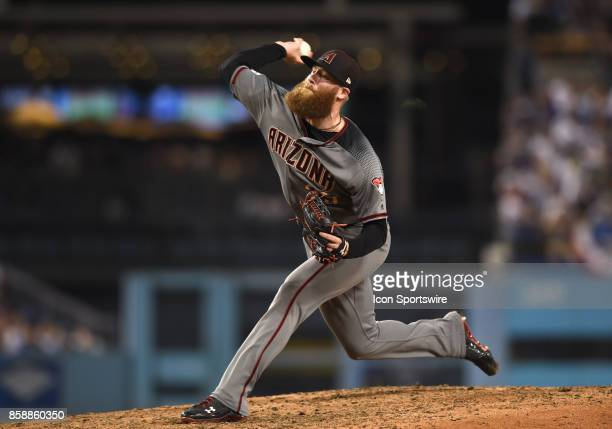 Arizona Diamondbacks pitcher Archie Bradley throws a pitch in the seventh inning during game 2 of the NLDS between the Arizona Diamondbacks and the...
