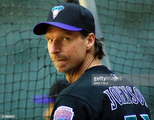 Arizona Diamondbacks' pitcher Randy Johnson waits his turn in the batting cage during an afternoon workout at Bank One Ballpark 24 October 2001 in...