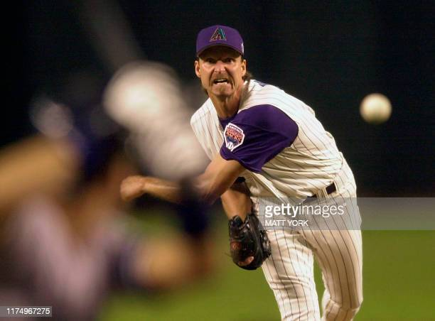 Arizona Diamondbacks' pitcher Randy Johnson watches his delivery to a New York Yankees batter during the 1st inning of Game 2 of the 2001 World...