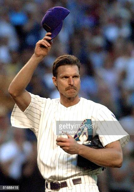 Arizona Diamondbacks' Randy Johnson tips his hat to the crowd after striking out San Francisco Giants' Reggie Sanders to collect his 3,500th career...