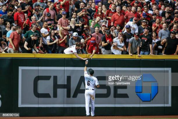 Arizona Diamondbacks right fielder David Peralta hands a ball to fans during the MLB National League Wild Card baseball game between the Colorado...