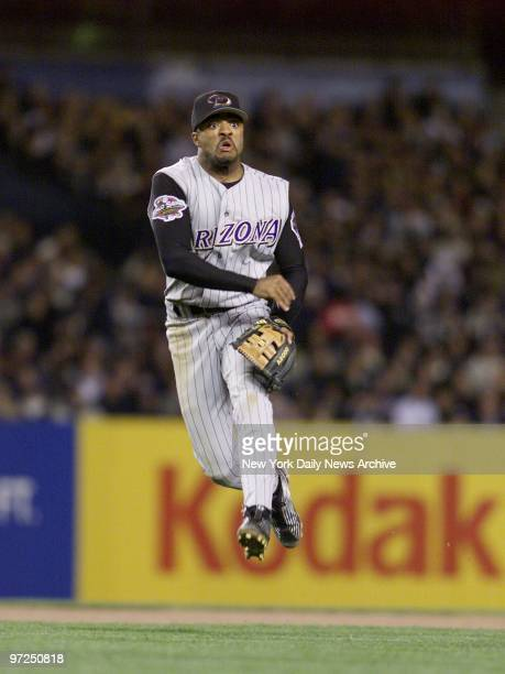 Arizona Diamondbacks' shortstop Tony Womack makes a throw to first for a putout in the first inning of Game 4 of the World Seriesagainst the New York...