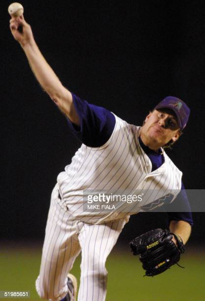 Arizona Diamondbacks starter Curt Schilling pitches the third inning against the St. Louis Cardinals during game five of the National League western...