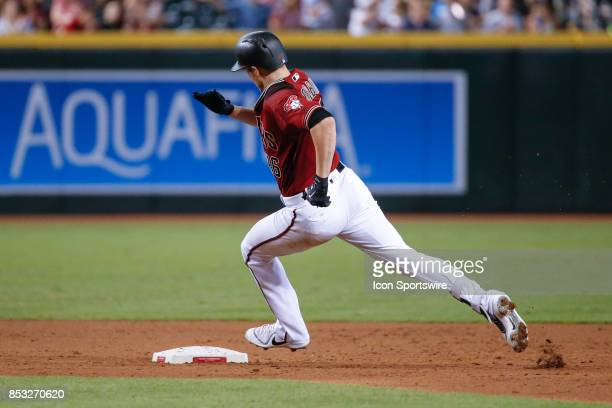 Arizona Diamondbacks starting pitcher Patrick Corbin rounds second base on his way to third base for a triple during the MLB baseball game between...