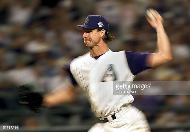 Arizona Diamondbacks starting pitcher Randy Johnson pitches during Game 2 of the 2001 World Series in Phoenix 28 October 2001. The New York Yankees...