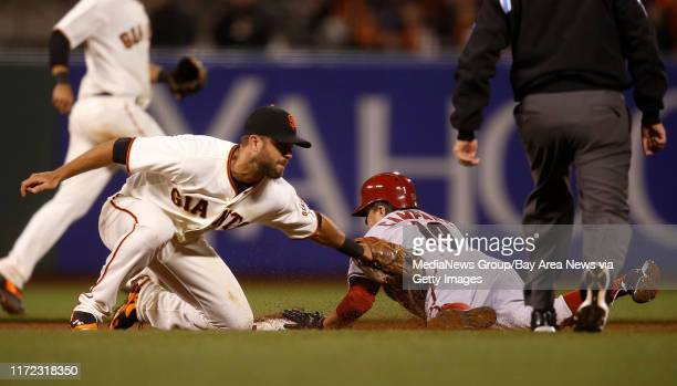 Arizona Diamondbacks' Tony Gonzalez slides safely into second base against San Francisco Giants' Brandon Hicks in the tenth inning at ATT Park in San...
