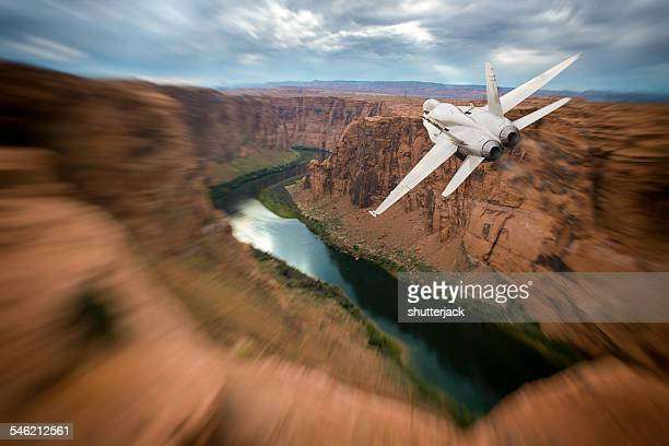 USA, Arizona, FA-18 Hornet flying over Colorado River