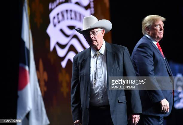 Arizona farmer Jim Chilton leaves after shaking hands with US President Donald Trump during the annual American Farm Bureau Federation convention in...