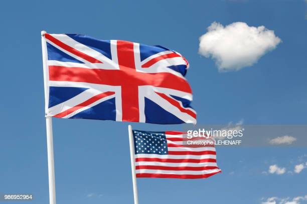usa. arizona. flags of the uk and usa floating in the sky. - stars and stripes stock pictures, royalty-free photos & images