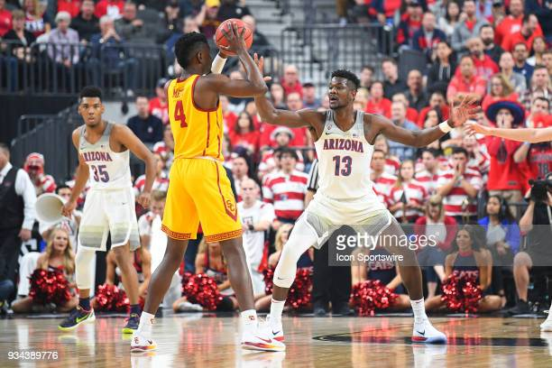 Arizona forward Deandre Ayton defends USC forward Chimezie Metu during the championship game of the mens Pac12 Tournament between the USC Trojans and...