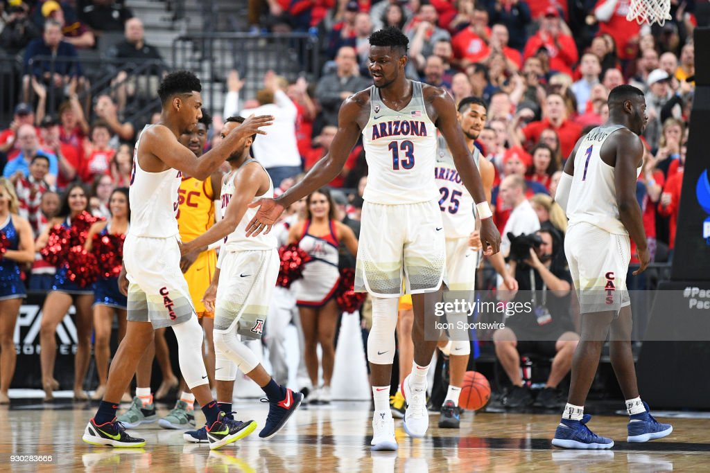 Arizona forward Deandre Ayton (13) gets a high five from Arizona guard Allonzo Trier (35) during the championship game of the mens Pac-12 Tournament between the USC Trojans and the Arizona Wildcats on March 10, 2018, at the T-Mobile Arena in Las Vegas, NV.