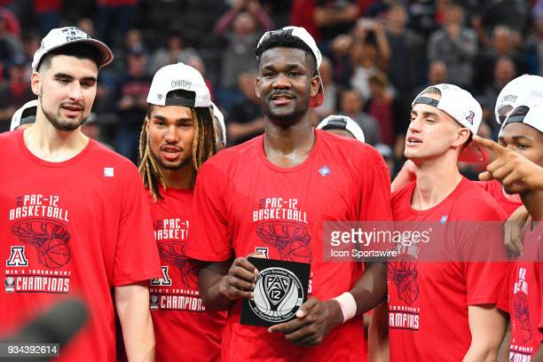 Arizona forward Deandre Ayton holds the AllTournament team plaque after the championship game of the mens Pac12 Tournament between the USC Trojans...