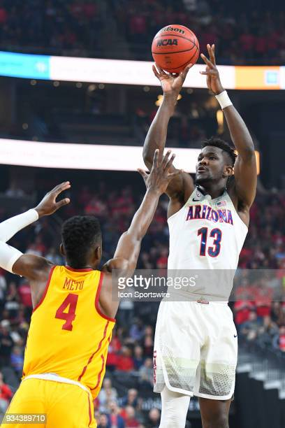 Arizona forward Deandre Ayton shoots over USC forward Chimezie Metu during the championship game of the mens Pac12 Tournament between the USC Trojans...