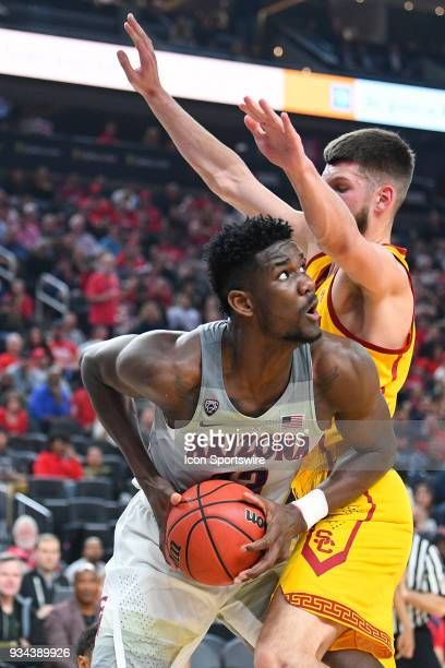 Arizona forward Deandre Ayton tries to score over USC forward Nick Rakocevic during the championship game of the mens Pac12 Tournament between the...