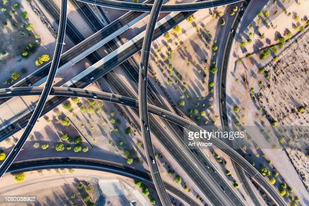 arizona freeway interchange aerial - integrated stock pictures, royalty-free photos & images