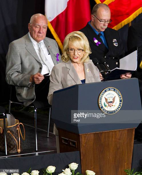 Arizona Gov Jan Brewer speaks during a memorial service honoring 19 fallen firefighters at Tim's Toyota Center July 9 2013 in Prescott Valley Arizona...