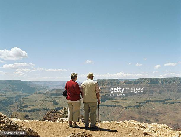 USA, Arizona, Grand Canyon, mature couple looking out  at the view