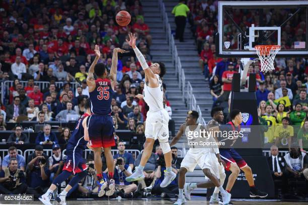 Arizona guard Allonzo Trier ] shoots a three pointer during the championship game of the Pac12 Tournament between the Oregon Ducks and the Arizona...