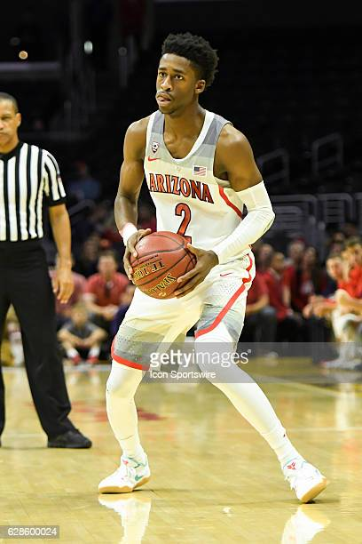 Arizona guard Kobi Simmons drives to the basket during an NCAA basketball game in the Hoophall LA showcase between the Arizona Wildcats and the...