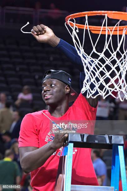 Arizona guard Rawle Alkins holds up his piece of the net after Arizona Wildcats defeated Oregon Ducks 8380 in championship game of the Pac12...