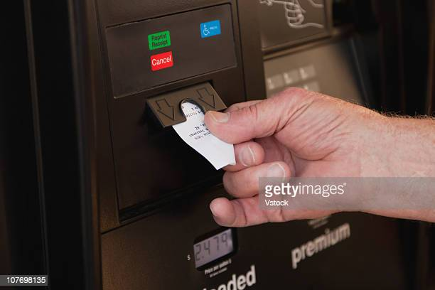 USA, Arizona, Hand taking out receipt from machine