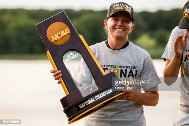Arizona head coach Laura Ianello poses with the trophy after her team won the Division I Women's Golf Team Match Play Championship held at the...