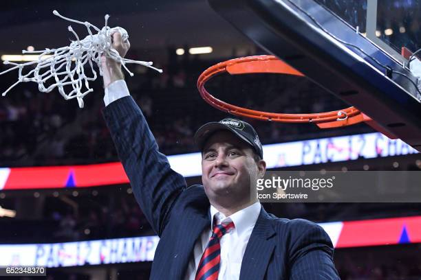Arizona head coach Sean Miller waves the net to the crowd after Arizona Wildcats defeated Oregon Ducks 8380 in championship game of the Pac12...