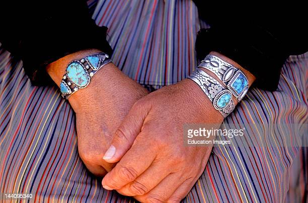 Arizona Hubbell'S Trading Post Close Up Of Hands With Navajo Jewelry Turquoise Silver Bracelets