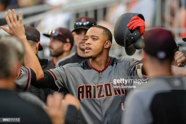 Arizona infielder Ketel Marte is congratulated by teammates after hitting a solo home run in the 6th inning during the game between Atlanta and...