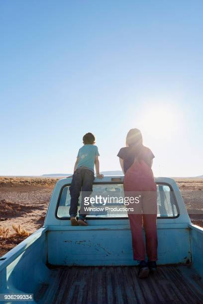 USA, Arizona, Mother with boy (6-7) looking at view from pick-up truck