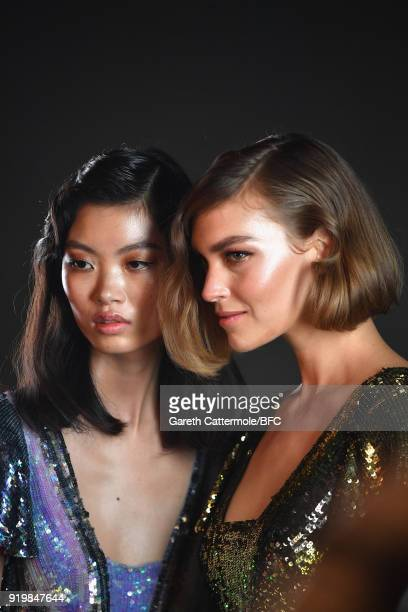 Arizona Muse and a model pose backstage ahead of the Temperley London show during London Fashion Week February 2018 at on February 18 2018 in London...