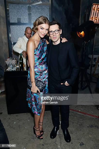 Arizona Muse and Erdem Moralioglu attend the Erdem x Selfridges Wrap Party during London Fashion Week Autumn/Winter 2016/17 at on February 22 2016 in...