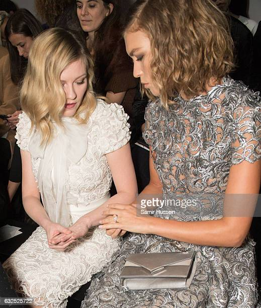 Arizona Muse and Kirsten Dunst compare rings as they attend the RalphRusso Haute Couture Spring Summer 2017 show as part of Paris Fashion Week on...