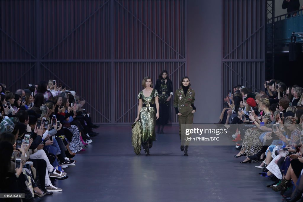 Arizona Muse (L) and models walk the runway at the Temperley London show during London Fashion Week February 2018 at on February 18, 2018 in London, England.