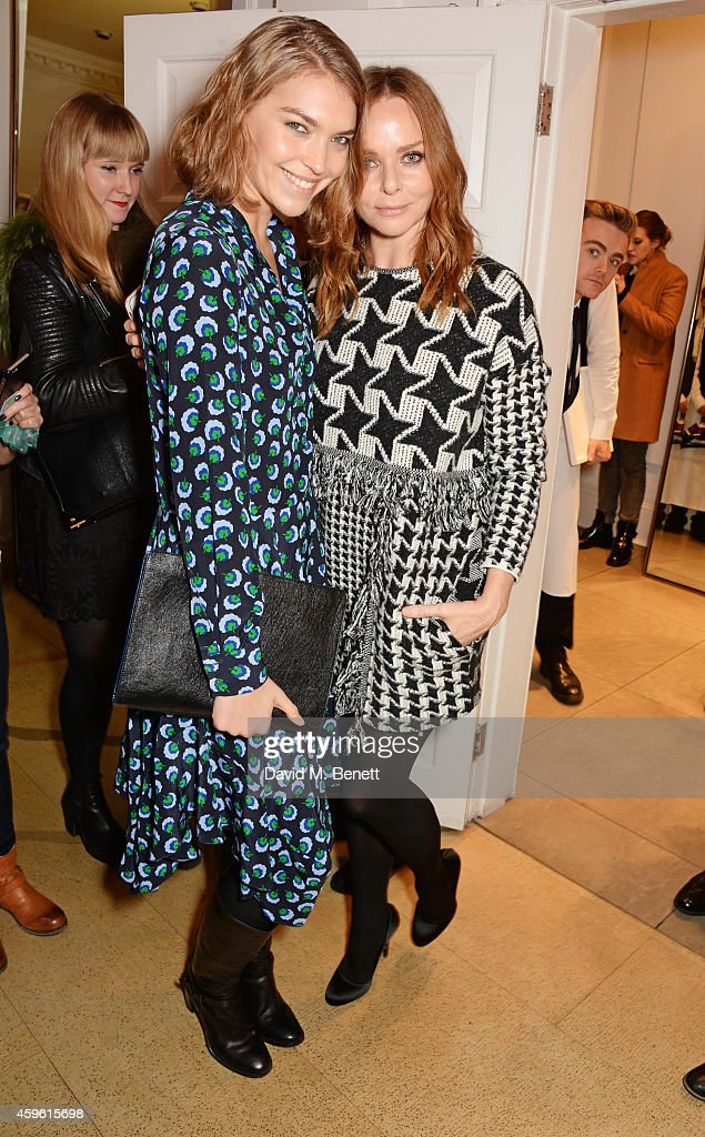 Arizona Muse (L) and Stella McCartney attend the Stella McCartney Christmas Lights Switch On at the Stella McCartney Bruton Street Store on November 26, 2014 in London, England.