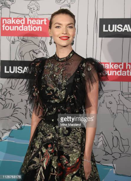 Arizona Muse arrives at the Fabulous Fund Fair event during London Fashion Week February 2019 at the The Roundhouse on February 18 2019 in London...