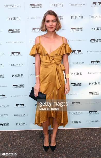 Arizona Muse attends a dinner hosted by Doutzen Kroes and Lucy Yeomans in honour of Save the Elephants at The Orangery on June 12 2017 in London...