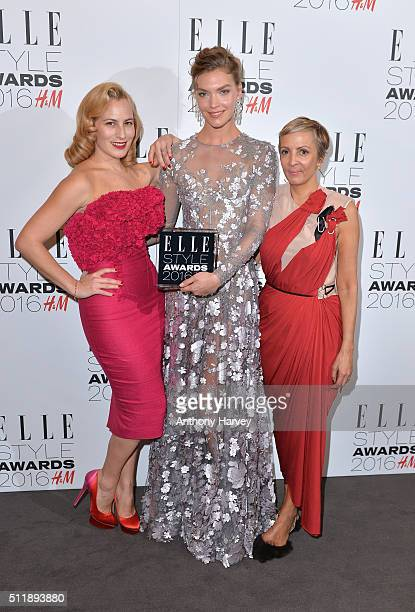 Arizona Muse poses with her award for Fashion Director's Woman of The Year with Charlotte Olympia and AnneMarie Curtis in the winners room at The...
