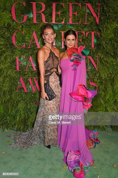 Arizona Muse wearing Stella McCartney for the Green Carpet Challenge and Livia Firth attend the Green Carpet Fashion Awards Italia at Teatro Alla...
