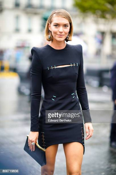 Arizona Muse wears a black dress and attends Le Defile L'Oreal Paris as part of Paris Fashion Week Womenswear Spring/Summer 2018 at Avenue Des Champs...