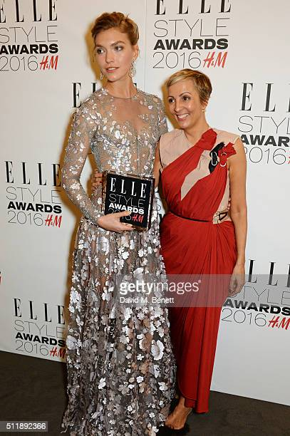 Arizona Muse winner of the Fashion Director's Woman of the Year award and AnneMarie Curtis pose in the winners room at The Elle Style Awards 2016 on...