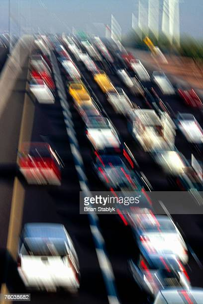 USA, Arizona, Phoenix, traffic on congested freeway, blurred motion, elevated view, rear view
