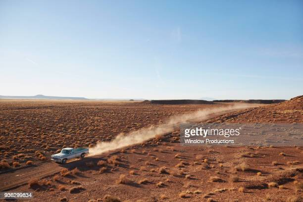 USA, Arizona, Pick up truck going through desert on Route 66