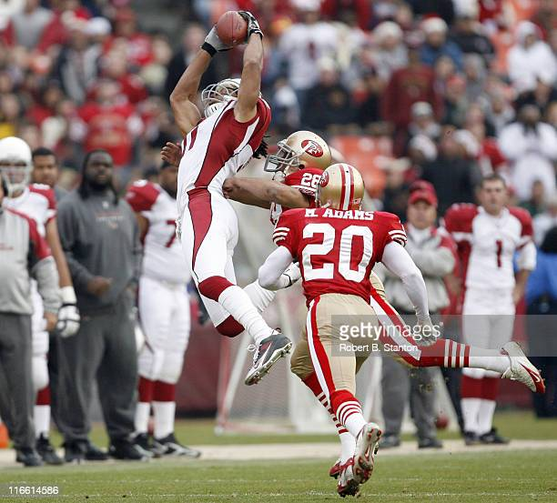 Arizona receiver Larry Fitzgerald hauls one in during the second half as the Arizona Cardinals defeated the San Francisco 49ers by a score of 26 to...