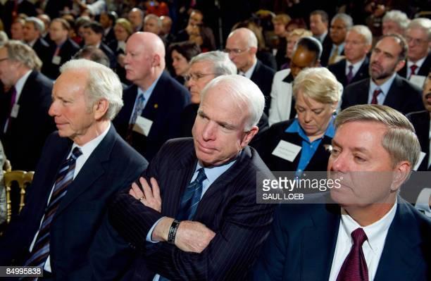Arizona Republican Senator John McCain listens alongside Connecticut Democrat Senator Joe Lieberman and South Carolina Republican Senator Lindsey...