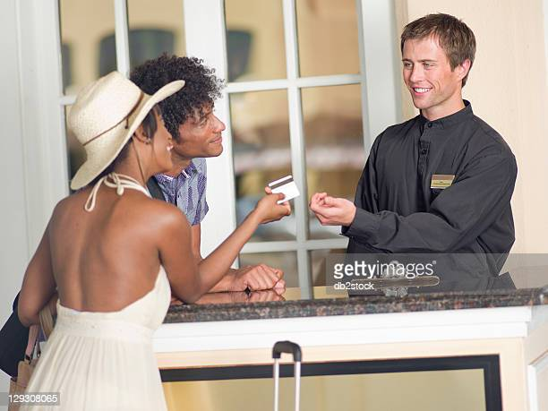 usa, arizona, scottsdale, couple checking in to hotel - valet stock photos and pictures