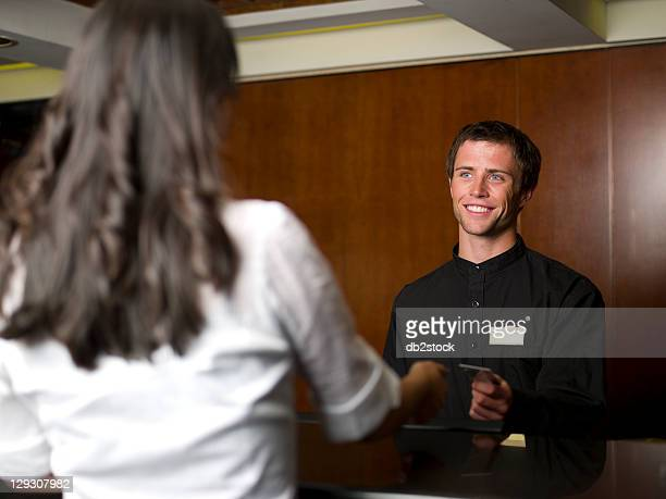 USA, Arizona, Scottsdale, Woman checking in or out of hotel