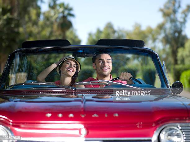 USA, Arizona, Scottsdale, Young couple driving convertible car