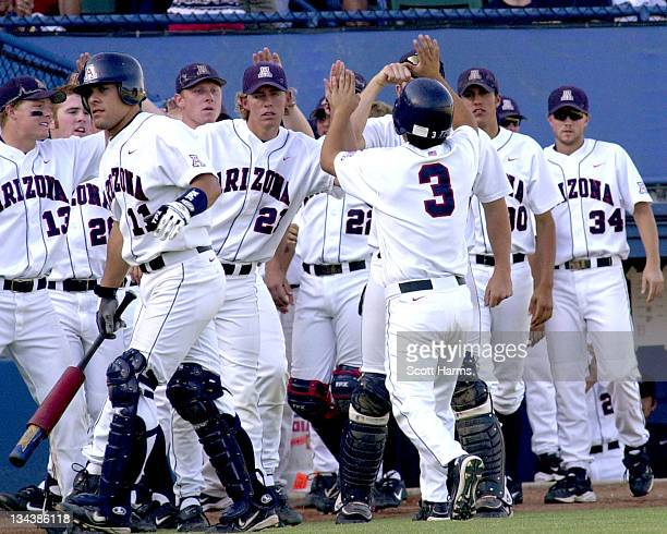 Arizona second baseman Moises Duran gets a warm welcome during game 2 against Long Beach State at the Division 1 Baseball Super Regionals at blair...